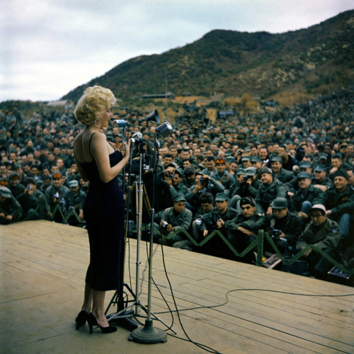 Marilyn singing in front of troops
