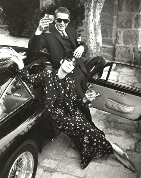Steve McQueen and Peggy Moffit, posing with his Ferrari 250 GT Berlinetta Lusso