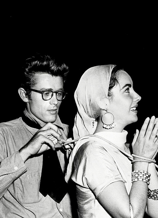 """James Dean and Elizabeth Taylor on the set of """"Giant"""", 1955."""