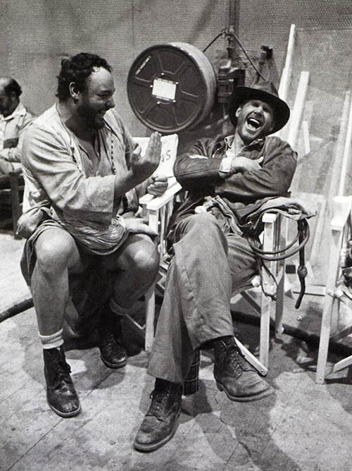 John Rhys-Davies and Harrison Ford on the set of Raiders of the Lost Ark (1981)
