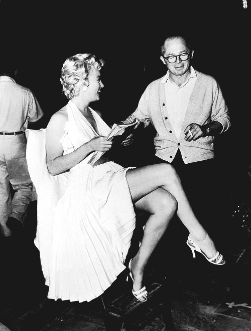 Marilyn Monroe and Billy Wilder behind the scenes of The Seven Year Itch (1955)