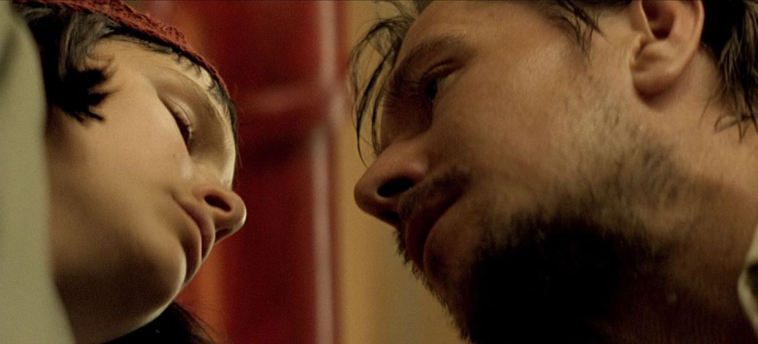 Gary Oldman as Norman Stansfield and Natalie Portman as Mathilda