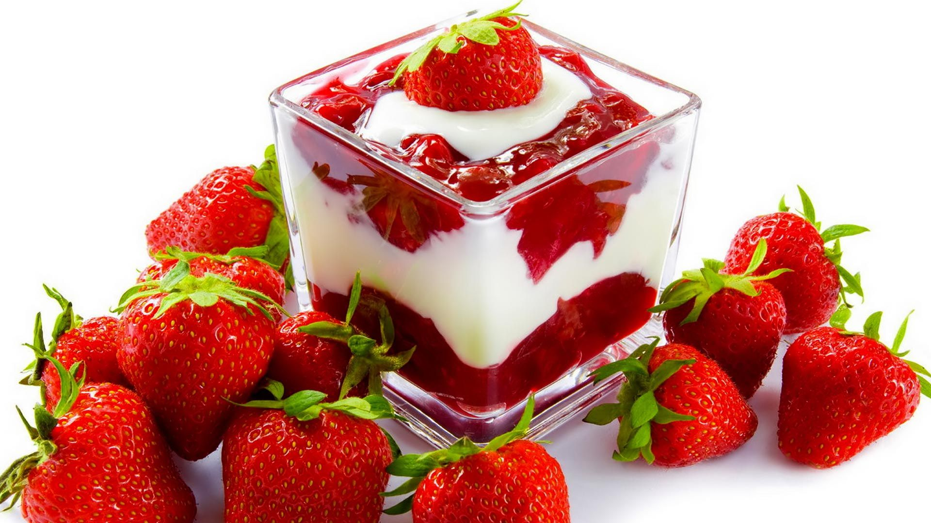 strawberry dessert with cream in a glass